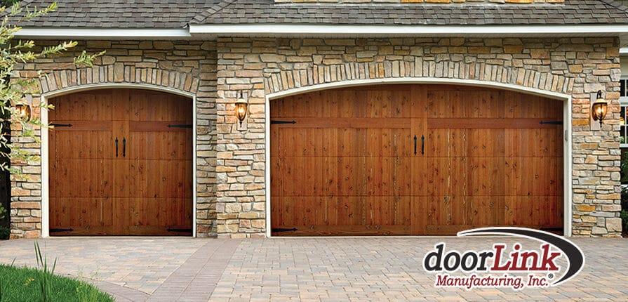 Pavers, custom doors, and stone on custom home.